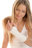 Woman with elastic wristban. Young woman with sprained wrist wearing elastic wristband Stock Photos