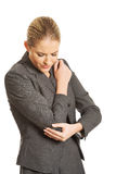 Woman with elbow pain Stock Photography