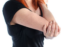 Woman with elbow pain. Woman holding her painful elbow Royalty Free Stock Photo