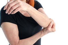 Woman with elbow pain. Woman holding her painful elbow Royalty Free Stock Photography