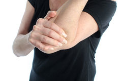 Woman with elbow pain. Woman holding her painful elbow Stock Images