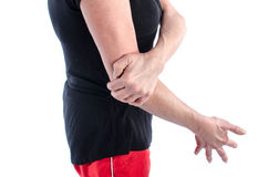 Woman with elbow pain. Woman holding her painful elbow Stock Photos