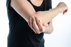 Woman with elbow pain. Woman holding her painful elbow Stock Image