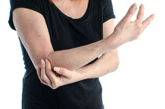 Woman with elbow pain. Woman holding her painful elbow Royalty Free Stock Photos