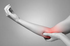Woman with elbow pain royalty free stock photography