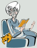 Woman elderly. An elderly woman sitting in an armchair and reading a book Stock Photos