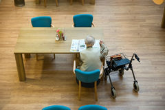 Woman in elderly home Stock Image