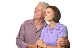 Woman  and  elderly man. Woman near an elderly men on a white background Stock Photos