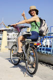 Woman on electric bike thumb up Royalty Free Stock Image