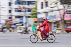 Woman on an electric bike transports groceries, Shanghai, China Royalty Free Stock Images