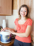 Woman with electric crock pot Stock Photo