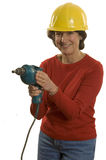 Woman with electric drill Royalty Free Stock Photos