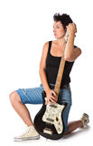 Woman with electric guitar. Isolated on white background Royalty Free Stock Photography