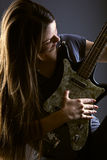 Woman with electric guitar. On gray background Royalty Free Stock Images