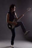 Woman with electric guitar. On gray background Stock Photo
