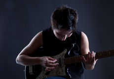 Woman with electric guitar. On gray background Stock Image