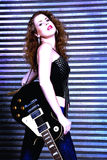 Woman with electric guitar Royalty Free Stock Images