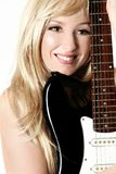 Woman with electric guitar Stock Image