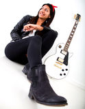 Woman with an electric guitar Stock Photo