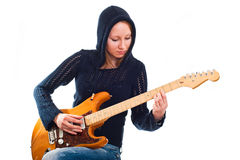 Woman with electric guitar. Young woman with electric guitar Royalty Free Stock Image