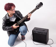 Woman and electric guitar Stock Image