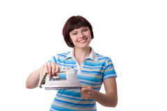 Woman with electric iron stock image