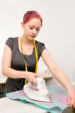 Woman with electric iron Royalty Free Stock Image
