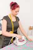 Woman with electric iron Stock Images