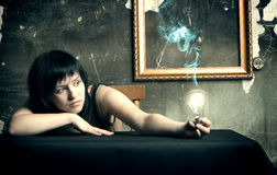 woman with an electric lamp Royalty Free Stock Photo