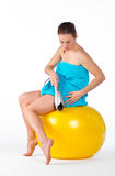 Woman with electric massager Royalty Free Stock Photo