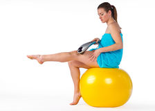 Woman with electric massager Stock Images