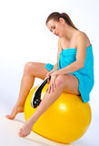 Woman with electric massager Stock Photography