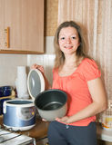 Woman with electric slow cooker Stock Image