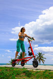Woman on an electric tricycle. In Miami royalty free stock photography