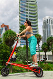 Woman on an electric tricycle. In Miami royalty free stock image