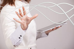 Woman with electrical cables or wires, curved lines Stock Photography