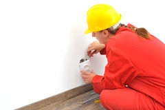 Woman electrician fixing socket Royalty Free Stock Photo