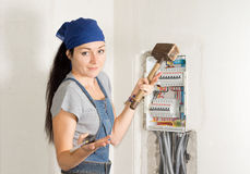 Woman electrician with a problem Stock Photos