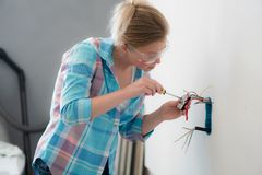 Free Woman Electrician Work At House. Professional Worker Royalty Free Stock Photography - 153073737