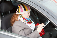 Woman with electronic device in car Royalty Free Stock Photos