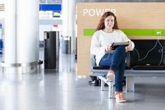 Woman with electronic devices near in arport Royalty Free Stock Photography
