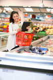 Woman with Electronic Shopping List Stock Photography