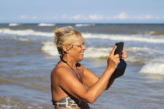 Woman with electronic tablet Stock Photo