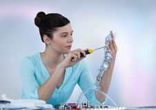 Woman with electronics against blurry background Royalty Free Stock Photo
