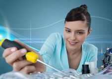 Woman with electronics and screwdriver against blue background with waves Royalty Free Stock Image