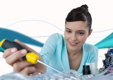 Woman with electronics and screwdriver against white background with blue waves Royalty Free Stock Image