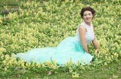 Woman in elegance dress lies on the Grass Stock Photos