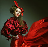 Woman in elegance red costume with red hat. Royalty Free Stock Photos