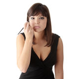 Woman in elegant black dress does a make up Royalty Free Stock Images