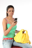 Woman in elegant clothes looks at a mobile phone Royalty Free Stock Photo